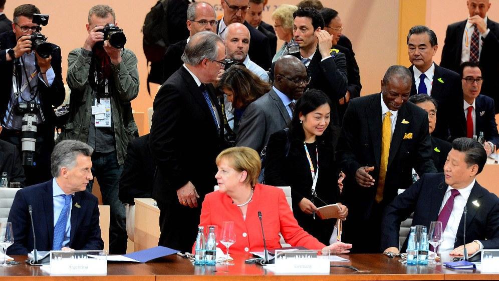 Angela Merkel (Mitte) und Xi Jinping (rechts) zusammen mit dem argentinischen Präsidenten Mauricio Macri beim G20-Gipfel 2017