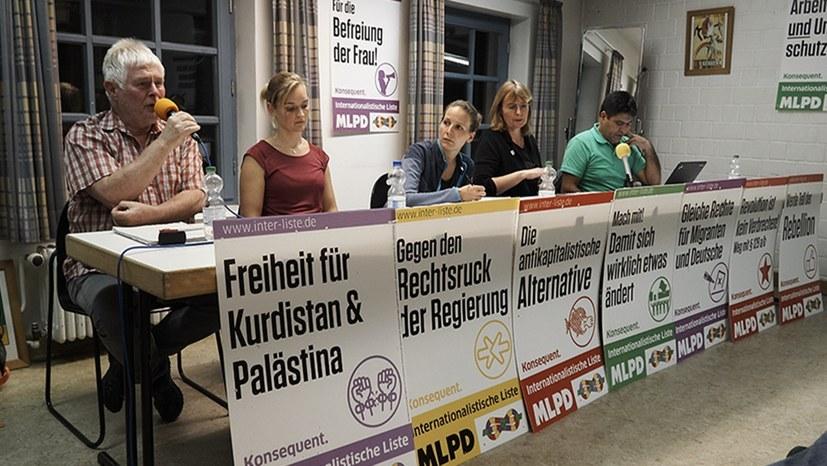 Siegmar Herrlinger (links) bei einer Veranstaltung des Internationalistischen Bündnisses in Braunschweig (Foto: RF)
