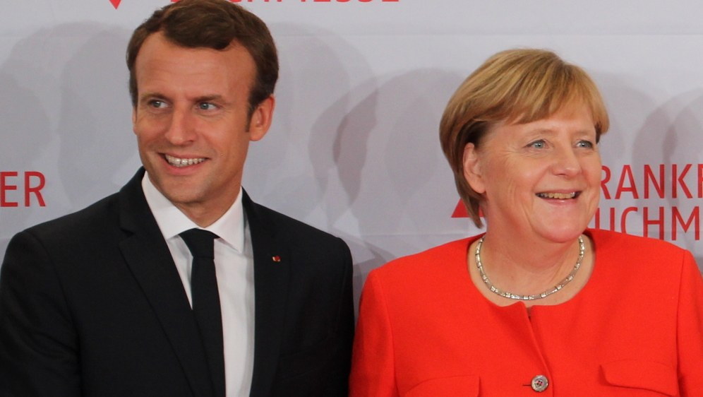 Bündnispartner Macron und Merkel - keineswegs fortschrittlichere Alternative zu den ultrareaktionären, faschistoiden Regierungen in der EU (Foto: ActuaLitté)