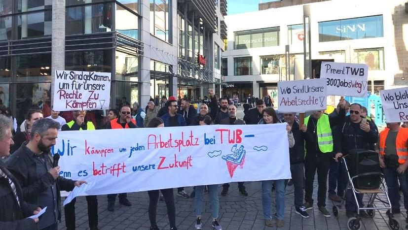 """""""Wir kämpfen um unsere Arbeitsplätze – eine Belegschaft die kämpft, darf nicht allein stehen!"""""""