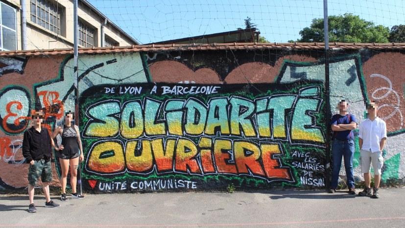 ICOR-Mitgliedsorganisation UCL sprüht sich solidarisch mit Nissan-Belegschaft