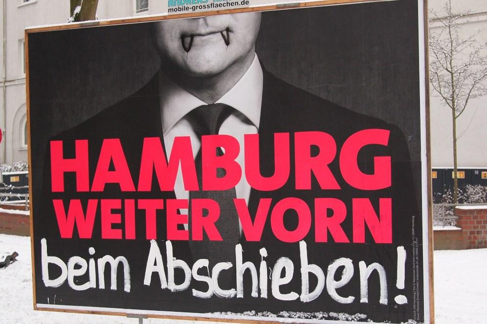 Kommentiertes Bundestagswahlplakat von Olaf Scholz