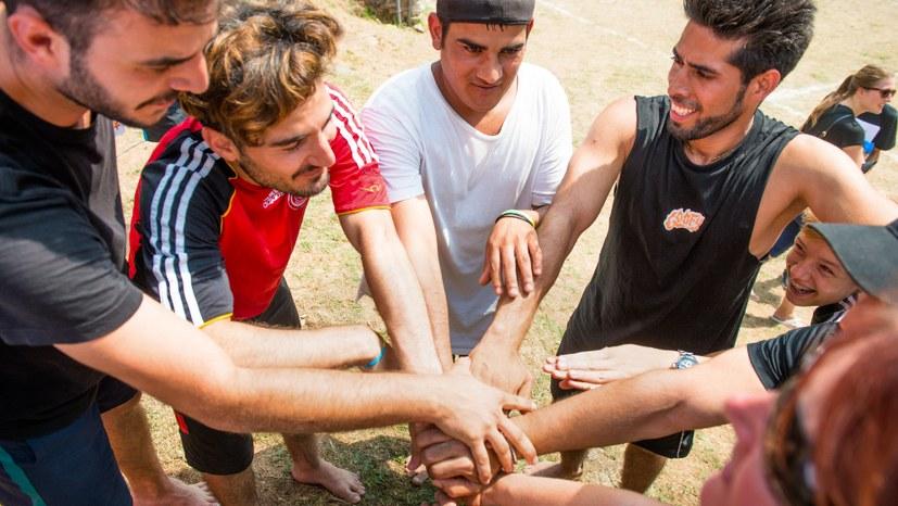 19 Unser Motto beim Sport_Freundschaft im Wettkampf.jpg